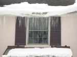 Icicles on White Brick House