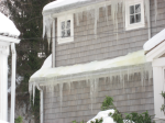 Icicles on Gray House